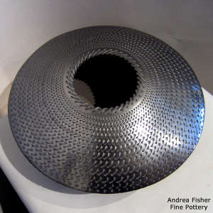 Textured surface finish on a flying saucer jar