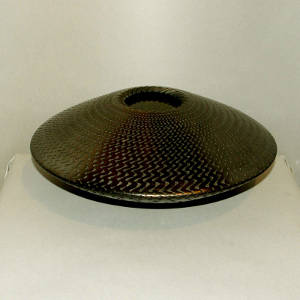 Corrugated surface on a graphite black flying saucer jar
