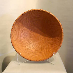Corrugated surface on a large red bowl