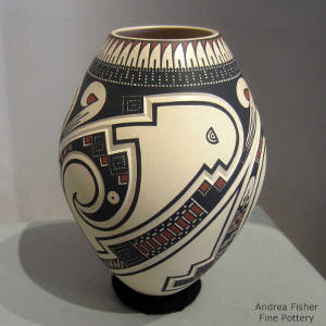 Geometric design lightly carved into and painted on a polychrome jar