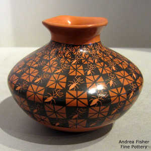 Quadrillos geometric design and sgraffito ants on a red and black jar with a square rim