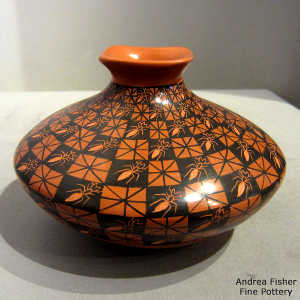 Sgraffito ants and painted quadrillos geometric design on a polychrome jar