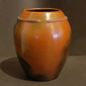 A twisted biyo and fire clouds on a brown vase