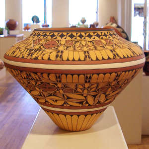 Repeating geometric designs on a large polychrome jar