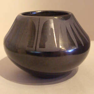 Kiva step and geometric design on a black on black jar