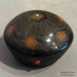 Sgraffito avanyu, spider web and geometric designs plus inlaid coral and turquoise on a black seedpot with sienna spots