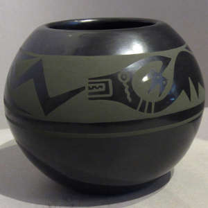 Green slip avanyu design on a black jar