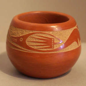 Sgraffito avanyu design on a red bowl