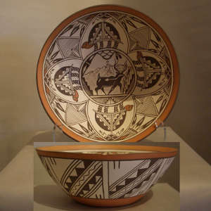 Turtle medallions, deer heart line and geometric design on a polychrome bowl