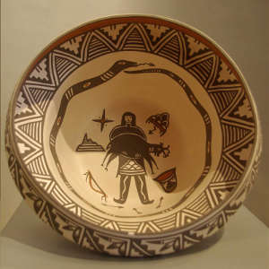 Hunter, avanayu and geometric design inside and geometric design outside on a polychrome bowl