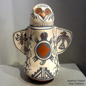Corn, cloud, checkerboard, moth, thunderbird, turtle, kiva step and geometric design on a polychrome owl effigy