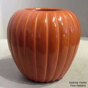 Red melon jar with carved ribs