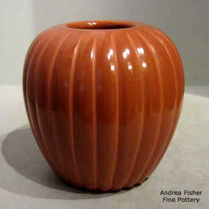 Red jar carved with a melon design