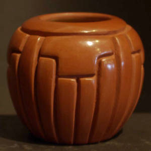 Ribs and kiva step design carved into a red jar