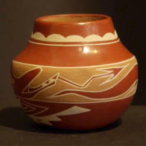 Avanyu, cloud and geometric designs on a polychrome jar