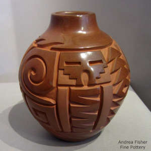 Tularosa spiral, kiva-swtep and geometric design carved into a polished red jar