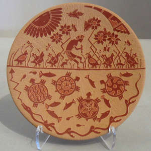 Sgraffito fish, turtle, quail, kokopelli and geometric designs on a red plate