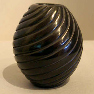 Spiral design carved into a black jar