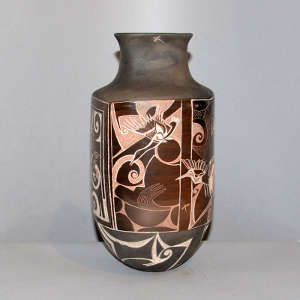 Four panel sgraffito goose and geometric design on a black and brown jar