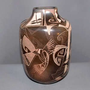 Sgraffito hummingbird and geometric design on a brown jar