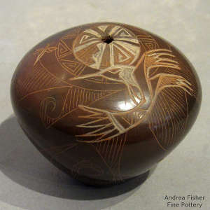 Sgraffito dragonfly, hummingbird and geometric design on a sienna seed pot