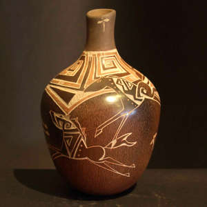 Sgraffito horses, dragonflies and geometric design on a brownware vase