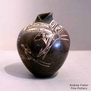 Sgraffito horse and geometric design on a brown jar
