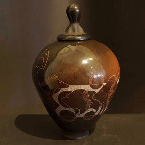 Sgraffito buffalo, horse and geometric designs on a brown and black jar