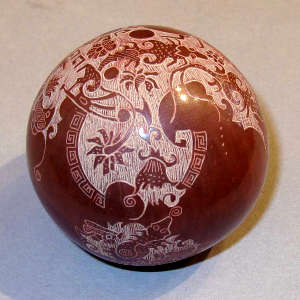 Sgraffito nature design on a miniature red seed pot
