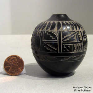 Sgraffito feather, avanyu and geometric design on a miniature black jar