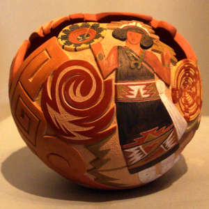 Carved, sgraffito and painted woman, baskets and geometric design on a polychrome jar with an organic opening