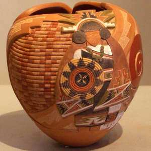Carved and painted woman, basket, spiral and geometric design on a polychrome jar with organic opening