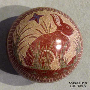 Sgraffito and painted rabbit, nature and geometric design on a polychrome seed pot