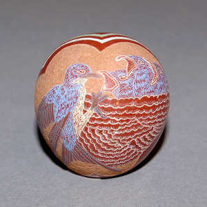 Sgraffito and painted cluds, nest and bird feeding chicks design on a polychrome seed pot