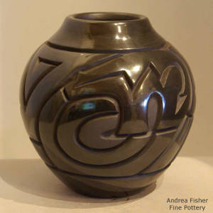 Bear and Tularosa spiral design carved into a black jar