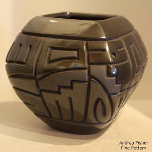 Yei design carved into a squarish black bowl