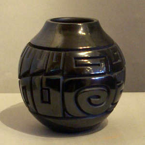 Tularosa spirals and geometric design carved into a black jar