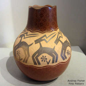 Sgraffito animal and flower design on a sienna jar
