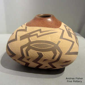 Sgraffito pronghorn and geometric design on a sienna jar