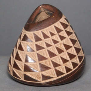 Sgraffito geometric design on a brown jar with triangular opening