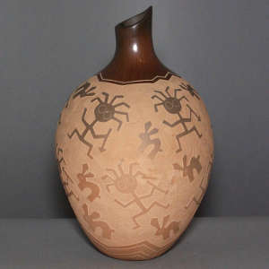 Sgraffito hunter and rabbit design on a brown jar