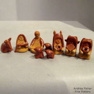 Thirteen pieces in a miniature red nativity set