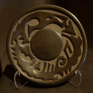 An avanyu design carved into a black plate