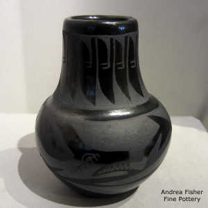 Avanyu, feather and geometric design on a black on black jar