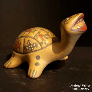 Animal, insect and geometric design on a polychrome turtle figure