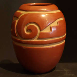 Geometric designs carved into a red jar