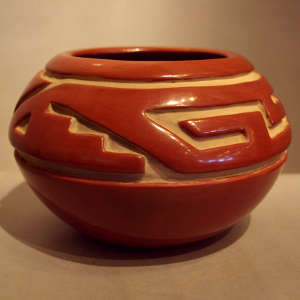 Geometric design carved into a red jar