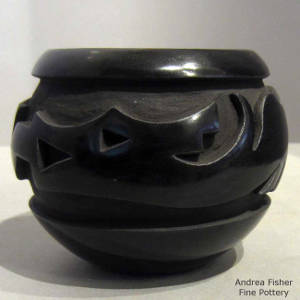 Avanyu design carved into a black jar