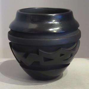 Avantyu design carved into a black jar