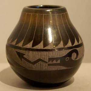 Sgraffito feather and avanyu design on a black jar
